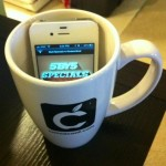 Of course the CocoaConf Mug gets used as an iPhone amplifier...